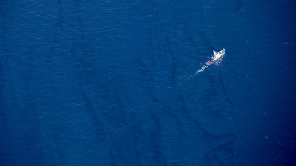 An aerial view Monday reveals one of the oil slicks on the surface of the East China Sea, reminders of the deadly explosion that sank an Iranian tanker. The spill continues to grow.