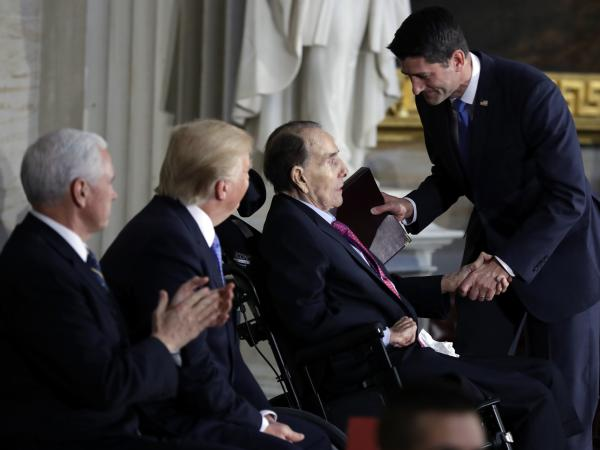 President Trump and Vice President Pence watch as House Speaker Paul Ryan of Wis., greets former Sen. Bob Dole during a Congressional Gold Medal ceremony honoring Dole on Capitol Hill Wednesday.