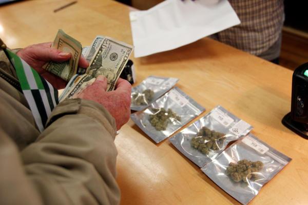 <p>A customer purchases marijuana at Harborside marijuana dispensary in Oakland, California, Jan. 1, 2018.</p>