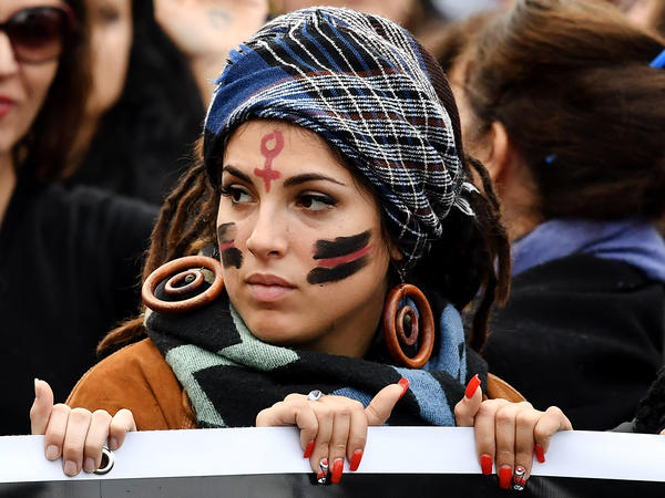 A woman takes part in a demonstration to mark the International Day for the Elimination of Violence Against Women in Rome in November.