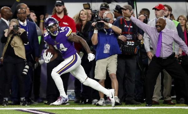 In this Sunday, Jan. 14, 2018, file photo,  Minnesota Vikings wide receiver Stefon Diggs (14) looks back as he runs down the sideline for the game-winning touchdown Saints late in the second half of an NFL divisional football playoff game against the New Orleans in Minneapolis. The Vikings defeated the Saints 29-24. (Jeff Roberson, File/AP)