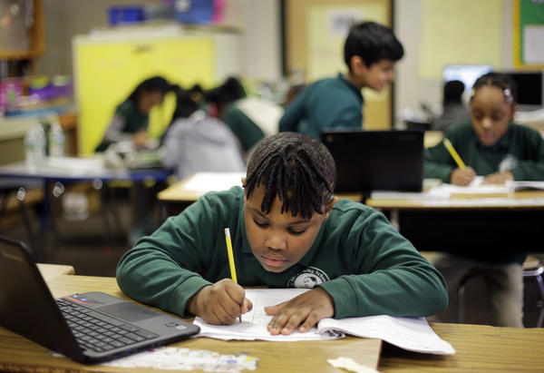 Justin Beckles works on a project in his third-grade classroom at the Martin Luther King Jr. Elementary School in Hartford, Conn., in 2017.
