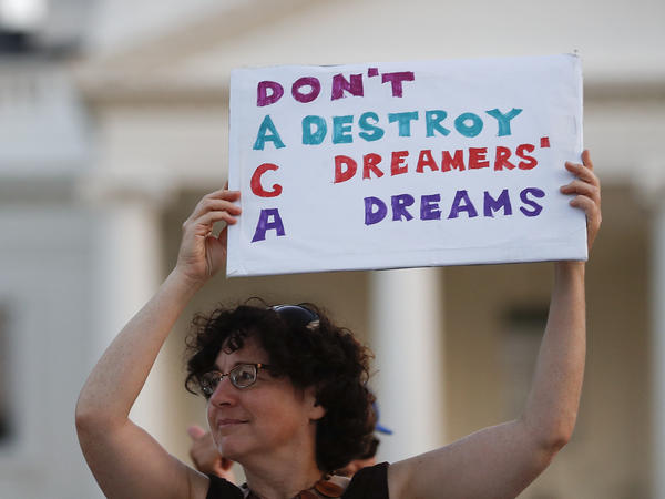 Protesters supporting the Deferred Action for Childhood Arrivals program demonstrate outside the White House.