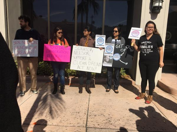 DREAMERS and activists stand outside Senator Bill Nelson's office in Coral Gables