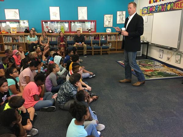 Missouri Treasurer Eric Schmitt talks to fourth graders in the North Kansas City School District about saving for college. Missouri families can now use their 529 plans to get a tax break on K-12 private school tuition.