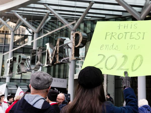 Approval of U.S. leadership fell sharply in President Trump's first year — particularly in Canada, where the approval rating fell from 60 percent to 20 percent. In this photo, protesters demonstrate at a new Trump International hotel in Vancouver last year.