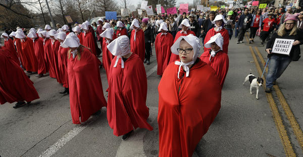"Members of the ""Texas Handmaids"" lead a women's march to the Texas State Capitol."