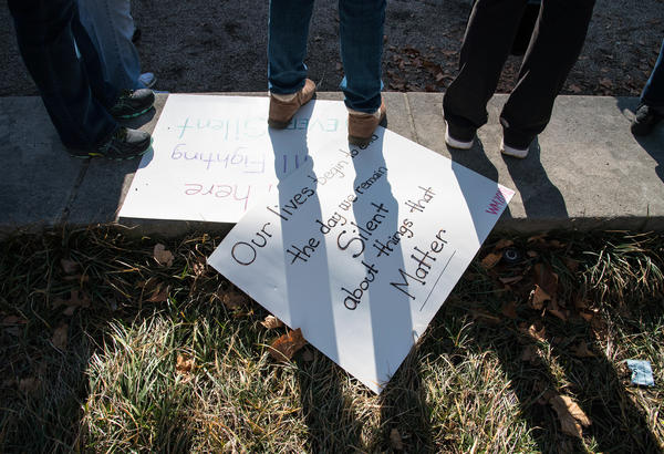 Homemade signs for lay on the ground as the crowd rallies together in Baltimore.