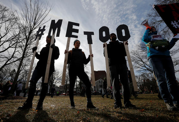 "Demonstrators spell out ""#METOO"" during the local second annual Women's March in Cambridge, Massachusetts."