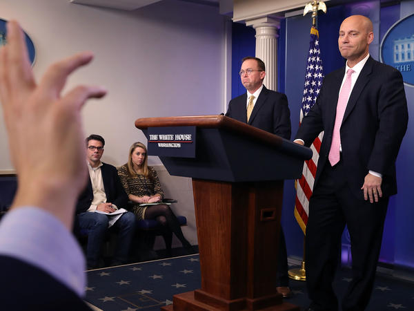 Office of Management and Budget Director Mick Mulvaney (2nd right) and White House Legislative Affairs Director Marc Short (right) hold a news conference about the ongoing partial shutdown of the federal government on Saturday.