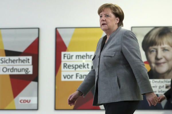 German Chancellor and chairwomen of the German Christian Democratic Union (CDU), Angela Merkel, arrives for a statement at the party's headquarters in Berlin, Germany, Sunday.