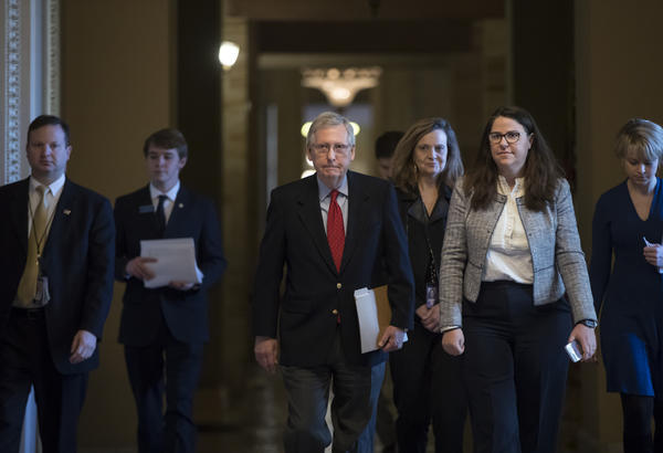 Senate Majority Leader Mitch McConnell, R-Ky., walks to the chamber on the first morning of a government shutdown after a divided Senate rejected a funding measure last night, at the Capitol in Washington, Saturday, Jan. 20, 2018.
