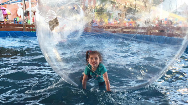 Evangelina Padilla-Vaccaro, now cured of a serious genetic illness — thanks to a successful stem cell treatment — playing recently in a public park. The bubble around her is just for fun.