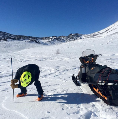 <p>A snow-machine rider takes a snowpack reading as part of Community Snow Observations, a NASA-sponsored citizen science project.</p>