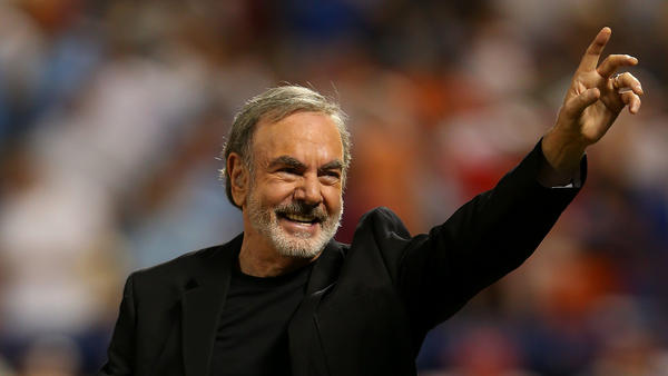 Neil Diamond performs during the 84th Major League Baseball All-Star Game on July 16, 2013 in New York. The singer announced his retirement from performing after being diagnosed with Parkinson's disease.