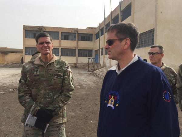 CENTCOM commander Joseph Votel (left) stands with USAID Administrator Mark Green during a media tour of Raqqa, Syria, on Monday.