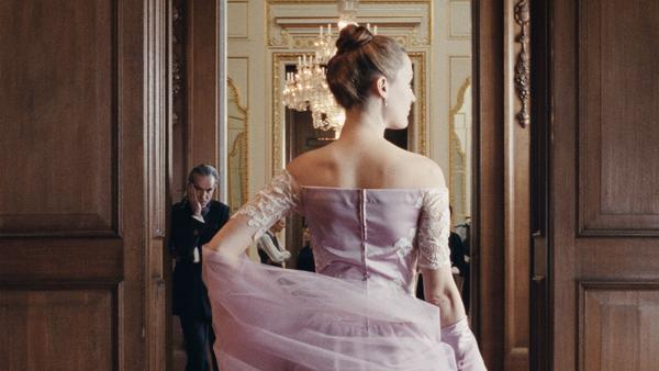 Daniel Day-Lewis (left) plays a renown fashion designer, and Vicky Krieps is his muse, in <em>Phantom Thread</em>.