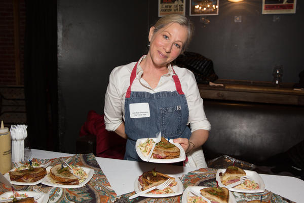 Chef Heidi Rae Weinstein holds a Reuben sandwich, complete with Swiss cheese — definitely a kosher no-no — at Trefa Banquet 2.0, an event held in San Francisco to commemorate a scandalous meal held in 1883 by newly ordained rabbis of the Jewish reform movement. The event has practically become myth.
