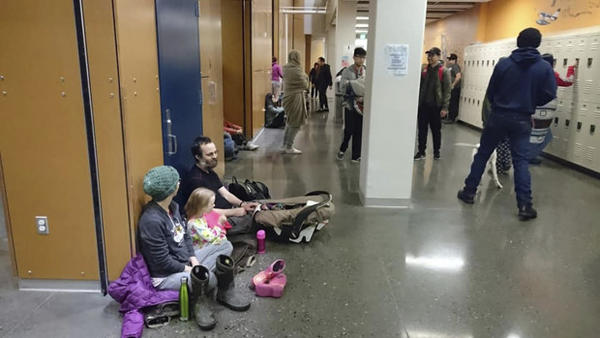 <p>Evacuees gather at Kodiak High School in Kodiak, Alaska, Tuesday, Jan. 23, 2018, after an earthquake and tsunami alert. A powerful undersea earthquake sent Alaskans fumbling for suitcases and racing to evacuation centers in the middle of the night Tuesday after a cellphone alert warned that a tsunami could smash into the state's southern coast and western Canada.</p>