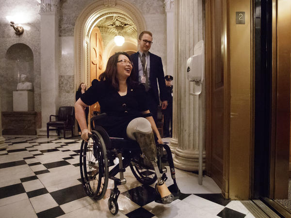 Sen. Tammy Duckworth, D-Ill., leaves the Senate chamber on Capitol Hill in Washington, in February 2017.