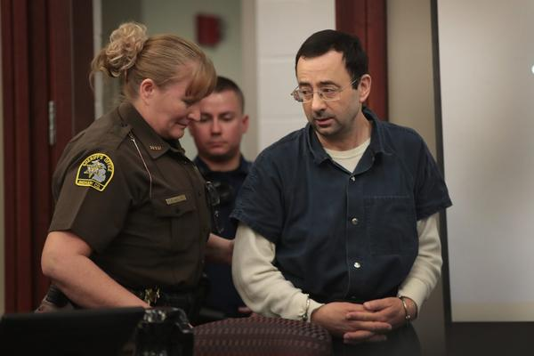 Larry Nassar arrives in court to listen to victim impact statements during his sentencing hearing after being accused of molesting more than 100 girls while he was a physician for USA Gymnastics and Michigan State University, where he had his sports medicine practice, on Jan. 17, 2018 in Lansing, Mich. (Scott Olson/Getty Images)