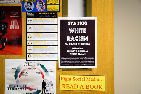 Flyer advertising White Racism course on Dr. Ted Thornhill's office door
