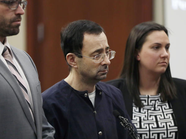 Larry Nassar in court with his attorneys on Wednesday, in Lansing, Mich., where he was sentenced to 40 to 175 years in prison.