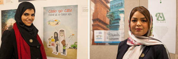 "(Left) Sheitha al-Aiyash, a motion graphics designer, stands with a poster for her project encouraging people to become more active. The poster reads, ""Food is not your entertainment. Look around you and change the way you think."" (Right) Rana Fatami stands in front of a poster for her ""Historical Jeddah"" tourism app."