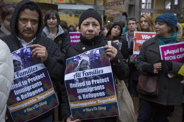"""More than 200 people turned up at the corner of Washington and School Streets to the SEIU immigrant rally in reaction to statements made by President Trump threatening to strip federal funding from so-called """"sanctuary cities."""""""