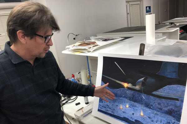 Artist Dru Blair shows his painting of a 1952 CIA operation in China that killed two pilots.