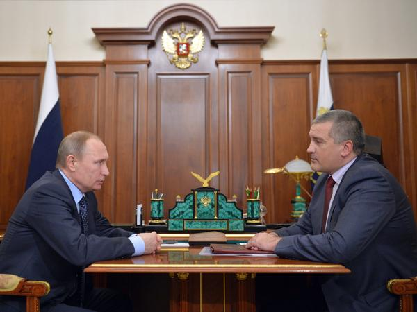Russian President Vladimir Putin, left, and Crimean leader Sergei Aksyonov meet face to face in the Kremlin in Moscow in February 2016.
