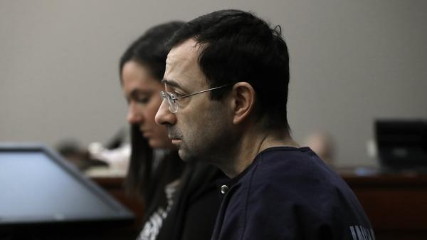 Michigan Attorney General announced on Saturday his office is launching an investigation into Michigan State University's handling of the sex abuse scandal. Disgraced sports doctor Larry Nassar is seen here as a victim gives her impact statement during his sentencing hearing on Jan. 24 in Lansing, Mich.