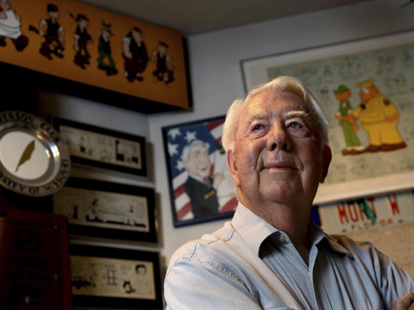In this August 2010 file photo, Mort Walker, the artist and author of the Beetle Bailey comic strip, stands in his studio in Stamford, Conn.