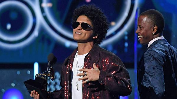 Bruno Mars received seven Grammys, including Album, Song and Record of the Year.