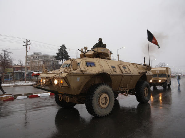 Afghan security personnel arrive at the site of an attack at the Marshal Fahim academy in Kabul, Afghanistan on Monday.