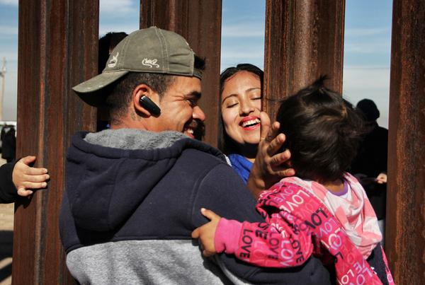 "Members of a family reunite through the border wall between Mexico and United States, during the ""Keep our dream alive"" event, in Ciudad Juarez, Chihuahua state, Mexico on December 10, 2017. Families separated by the border are reunited for three minutes through the fence that separates Ciudad Juarez Park in Mexico and Sunland in New Mexico, United States, during an event called ""Keep our dream alive"", organized by the Border Network for Human Rights on the International Human Rights Day."