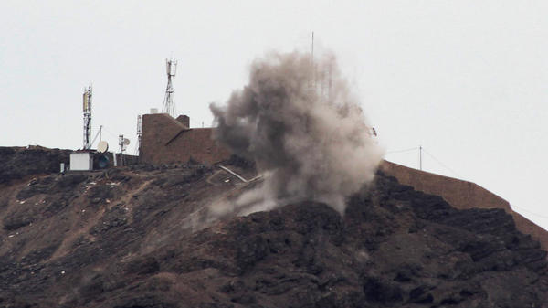 Smoke billows from a hilltop during clashes Sunday between southern separatists and forces loyal to the Saudi-backed Yemeni president in Aden.
