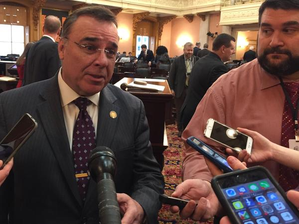 Rep. Kirk Schuring (R-Canton) tells a group of reporters that his bill to change the unemployment compensation fund is still moving through committee.