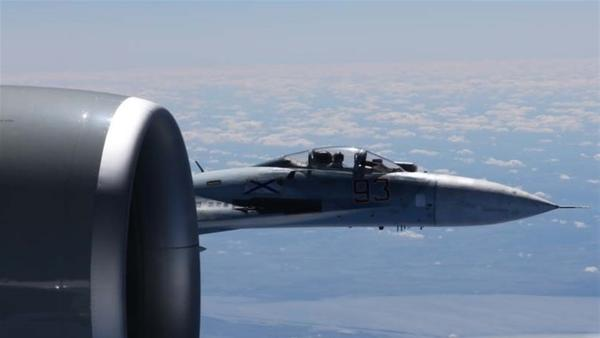 Dramatic photo of a Russian Su-27 jet coming within a few feet of a U.S. Air Force reconnaissance jet over the Baltic Sea in June of last year, in a maneuver that has been criticized as unsafe.