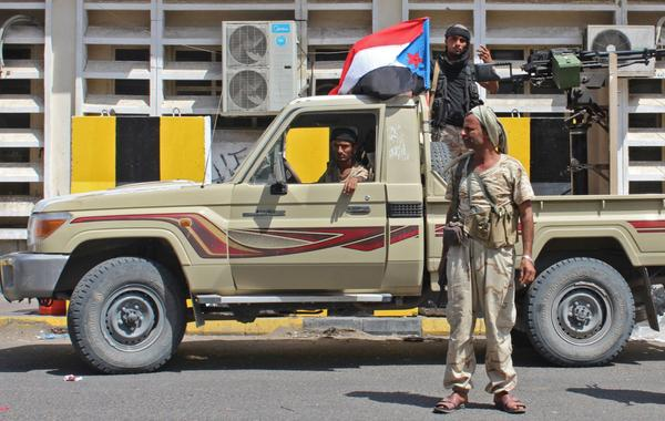 Separatist fighters fly the old, pre-unification flag of South Yemen above their pickup as they patrol Aden on Tuesday. Yemen's internationally recognized government has accused the separatist Southern Transitional Council of orchestrating a coup as it has moved closer to controlling the government's de facto capital.