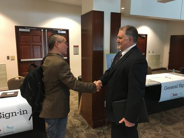 Yong Pei and Mike O'Connor shake hands at the event announcing the winners of the Idea Phase of the Third Frontier Commission's Ohio Opioid Technology Challenge.