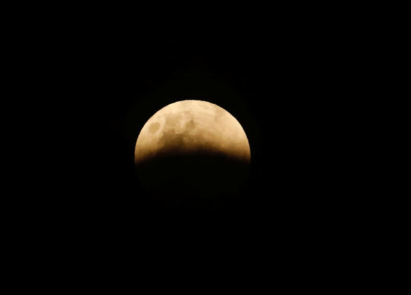 A full moon is seen during a lunar eclipse in Jakarta, Indonesia.