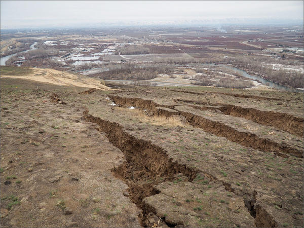 Geologists now say that the risk of a rapid, massive landslide on Rattlesnake Ridge is remote.