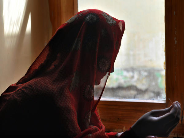 An Afghan woman makes handcrafts last October at a shelter run by women, for women. So-called honor killings are common in deeply conservative Afghanistan, along with other punishments for women suspected of contact with men outside their family.