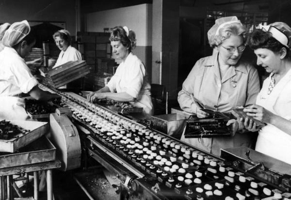 It was Cadbury that first linked Valentine's Day with those heart-shaped boxes filled with chocolates nestled in lace doilies. Here, women work on a production line at Cadbury's in England in 1966.