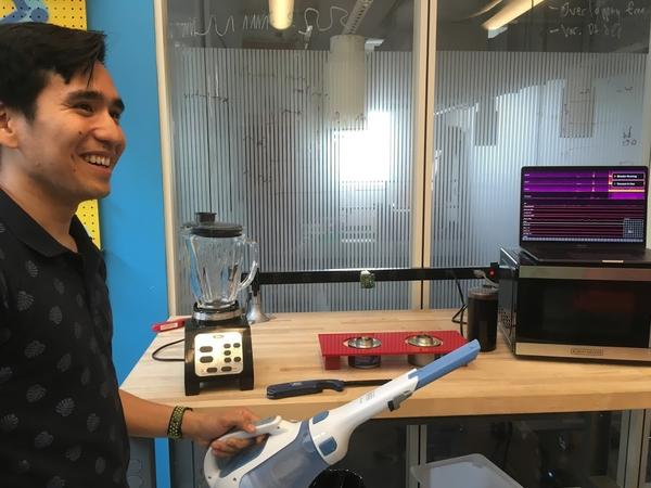 Gierad Laput, a Ph.D. student at Carnegie Mellon University, demonstrates how his team's universal sensor picks up the sound from a hand-held vacuum.