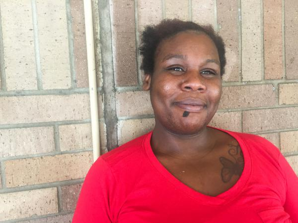 "Quinita Banks of nearby Port Arthur, Texas, came to the Beaumont Civic Center after her apartment flooded. ""I don't know what's going on. I don't know what's the next step,"" she says."