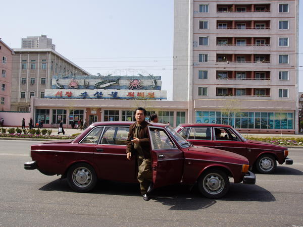 A man gets out of a Volvo 144 to head to a parade in Pyongyang in 2012. In the 1970s, North Korea ordered 1,000 Volvo 144s from Sweden. To this day, the cars have not been paid for.