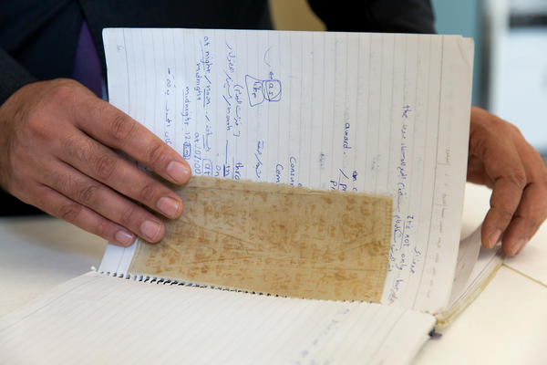 A piece of cloth and a notebook Omari donated to the U.S. Holocaust Memorial Museum in Washington, D.C.