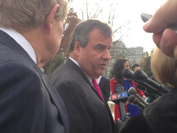 New Jersey Gov. Chris Christie answers questions about a sports gambling case after Supreme Court arguments on Monday.
